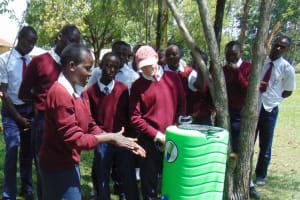 The Water Project: Ematiha Secondary School -  Student Demonstrates Handwashing