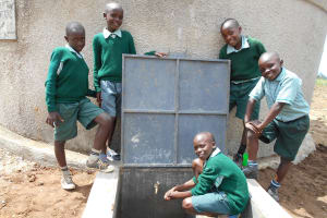 The Water Project: Mukangu Primary School -  Boys Pose With The Rain Tank