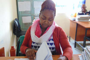 The Water Project: Malinda Secondary School -  Teacher Ms Jane At Her Desk