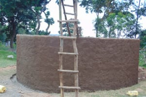 The Water Project: Musasa Primary School -  Ladders Stand Outside Newly Cemented Rain Tank