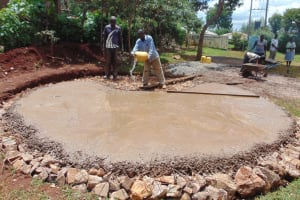 The Water Project: Womulalu Special School -  Adding Water To Concrete Foundation