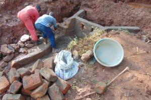 The Water Project: Mushina Community, Shikuku Spring -  Spring Wall Construction