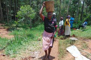 The Water Project: Shamakhokho Community, Imbai Spring -  Community Members Bringing Construction Materials