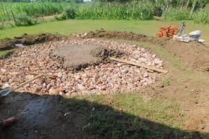 The Water Project: Shinyikha Primary School -  Rain Tank Stone Foundation Receives Concrete
