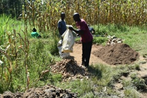 The Water Project: Sichinji Community, Kubai Spring -  Community Members Help Deliver Materials