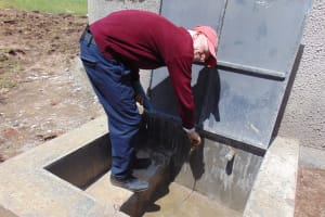 The Water Project: Ematiha Secondary School -  Student At The Rain Tanks Tap