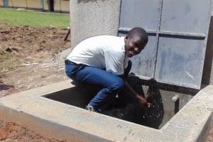 The Water Project: Ematiha Secondary School -  Student Enjoying The Rainwater