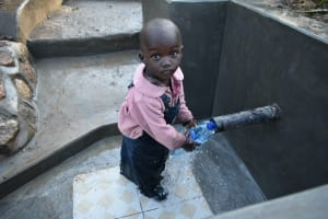 The Water Project: Sichinji Community, Kubai Spring -  Even Children Can Safely Access The Spring