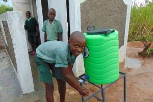 The Water Project: Mukangu Primary School -  Handwashing Outside The Boys Latrines
