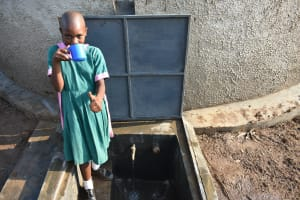 The Water Project: Shinyikha Primary School -  Having A Drink At The New Water Tank