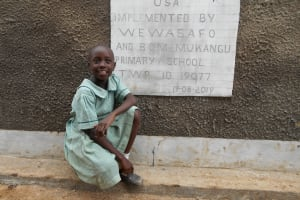 The Water Project: Mukangu Primary School -  Student In Front Of Girls Latrines