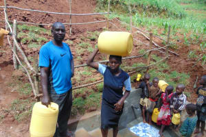 The Water Project: Shamakhokho Community, Imbai Spring -  Balancing Water Up The Stairs