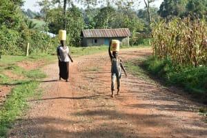 The Water Project: Sichinji Community, Kubai Spring -  Carrying Clean Water Home