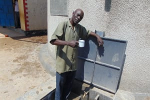 The Water Project: St. Margret Wadin'go Primary School -  Security Officer Mr John Were Wasike Gets A Drink From The Tank