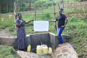 The Water Project: Sichinji Community, Kubai Spring -  Team Leader Emmah Wekesa And A Field Officer Saying Thanks