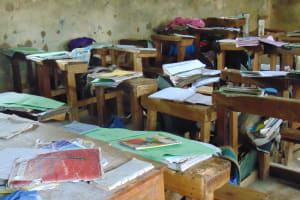 The Water Project: Kapsogoro Primary School -  Books On Desks While Students Enjoy A Break