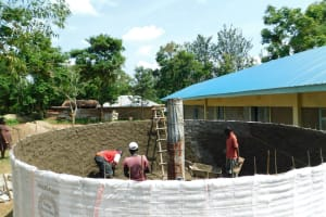 The Water Project: Enyapora Primary School -  Working Inside The Tank
