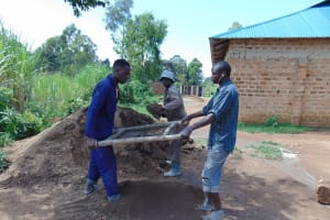 The Water Project: Mukangu Primary School -  Sifting Sand
