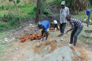 The Water Project: Bung'onye Community, Shilangu Spring -  Mixing Cement