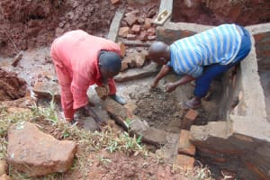The Water Project: Mushina Community, Shikuku Spring -  Wall Construction