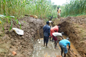 The Water Project: Hirumbi Community, Khalembi Spring -  Many Hands To Divery Water