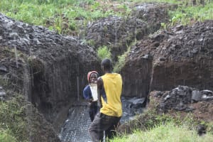 The Water Project: Emmachembe Community, Magina Spring -  Working Through The Rain