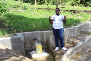 The Water Project: Bung'onye Community, Shilangu Spring -  Team Leader Catherine Chepkemoi Gives A Thumbs Up At Shilangu Spring