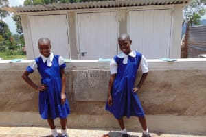 The Water Project: Goibei Primary School -  Girls Pose In Front Of Latrines