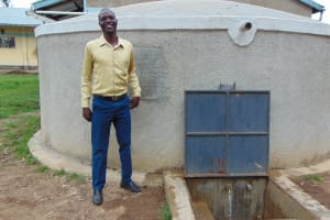 The Water Project: Ematiha Secondary School -  Teacher Stand Proud With The Rain Tank