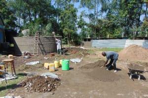 The Water Project: Ematiha Secondary School -  Construction Materials Surrounding Rain Tank