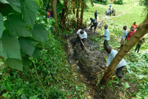 The Water Project: Bung'onye Community, Shilangu Spring -  Drainage Clearance