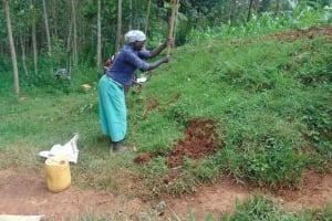 The Water Project: Shamakhokho Community, Imbai Spring -  Digging Cut Off Drainage