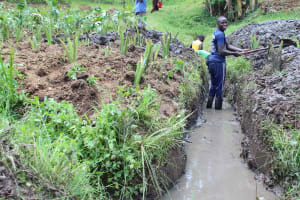 The Water Project: Emmachembe Community, Magina Spring -  Opening The Drainage Channel