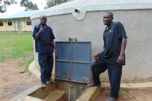 The Water Project: Ematiha Secondary School -  School Staff Stand Proud With The Rain Tank