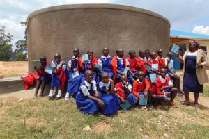 The Water Project: Goibei Primary School -  Students And Staff Pose With The New Tank
