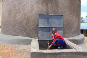 The Water Project: Goibei Primary School -  Student At The Rain Tanks Tap
