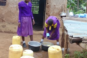The Water Project: Kapsogoro Primary School -  Students Wash Dishes Outside The Kitchen