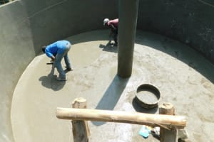 The Water Project: Enyapora Primary School -  Plastering Interior Of Tank