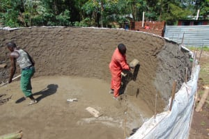 The Water Project: Ematiha Secondary School -  Cementing Interior Of Rain Tank Walls
