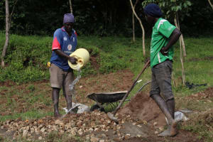 The Water Project: Emmachembe Community, Magina Spring -  Mixing Concrete