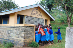 The Water Project: Kapsaoi Primary School -  Girls Squeeze In Line For The Latrines