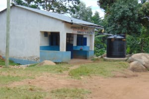 The Water Project: Kapsogoro Primary School -  Administration Building With Small Plastic Rain Tank