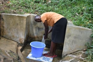 The Water Project: Mungakha Community, Asena Spring -  Gladys Enjoying The Spring Water