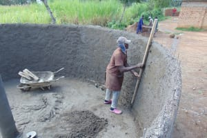 The Water Project: Mukangu Primary School -  Smoothing Cement Inside The Tank