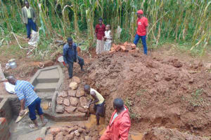 The Water Project: Hirumbi Community, Khalembi Spring -  Rub Wall Construction