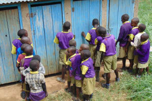 The Water Project: Kapsogoro Primary School -  Boys In Line At Latrines