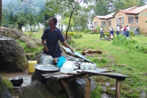 The Water Project: Friends Secondary School Shirugu -  School Cook Washing Dishes At The Dishrack