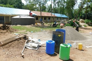 The Water Project: Enyapora Primary School -  It Takes Many Hands To Build A Rain Tank
