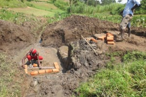 The Water Project: Emmachembe Community, Magina Spring -  Bricksetting And Measurements