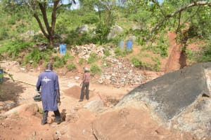 The Water Project: Kathuli Community -  Hauling Materials For Dam